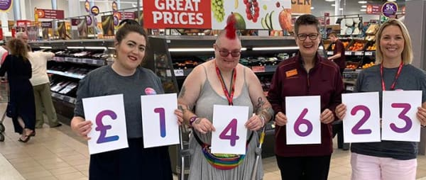 Volunteers standing proud in Sainsburys after raising thousands of pound for Autism Anglia